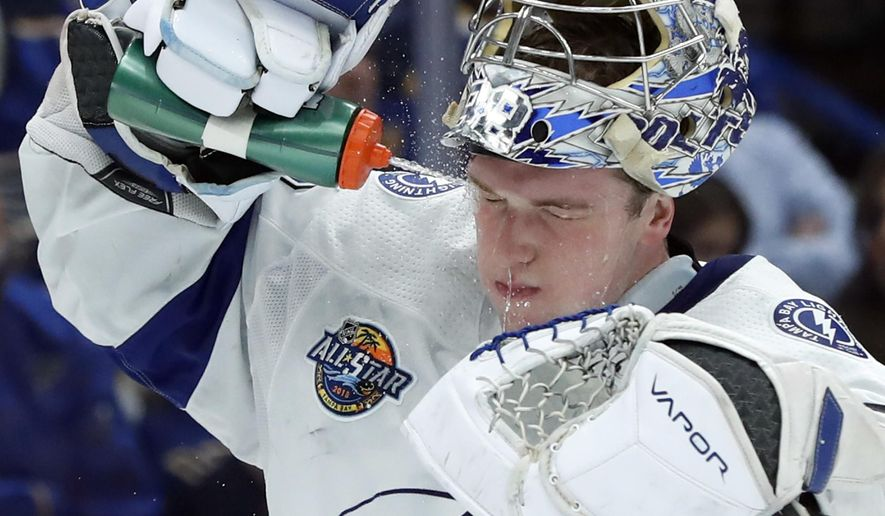 Tampa Bay Lightning goalie Andrei Vasilevskiy, of Russia, splashes his face during a timeout in the second period of an NHL hockey game against the St. Louis Blues Tuesday, Dec. 12, 2017, in St. Louis. (AP Photo/Jeff Roberson)