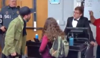 "A Connecticut college adviser has been charged with attempted theft and disorderly conduct for an altercation with Gateway Pundit writer Lucian Wintrich during his ""It's OK To Be White"" event at the University of Connecticut last month. (Twitter/@KallMeKG)"