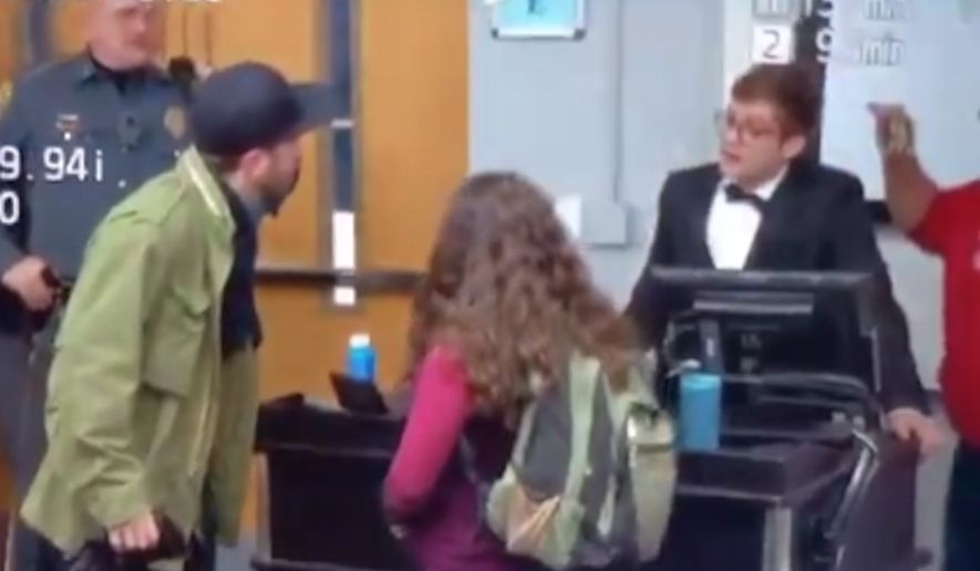 """A Connecticut college adviser has been charged with attempted theft and disorderly conduct for an altercation with Gateway Pundit writer Lucian Wintrich during his """"It's OK To Be White"""" event at the University of Connecticut last month. (Twitter/@KallMeKG)"""