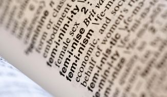 """This Monday, Dec. 11, 2017, file photo taken in New York shows the word feminism listed in the dictionary. Merriam-Webster has revealed """"feminism"""" as its word of the year for 2017 on Tuesday, Dec. 12. (AP Photo/Peter Morgan)"""
