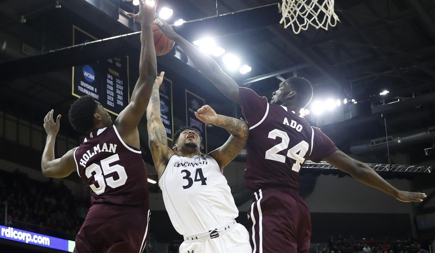 Mississippi State's Abdul Ado (24) blocks a shot by Cincinnati's Jarron Cumberland (34) in the first half of an NCAA college basketball game, Tuesday, Dec. 12, 2017, in Highland Heights, Ohio. (AP Photo/John Minchillo)