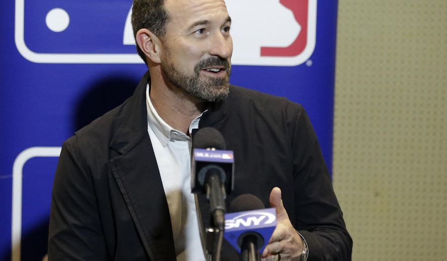 New York Mets manager Mickey Callaway talks with members of the media at the MLB baseball winter meetings Tuesday, Dec. 12, 2017, in Orlando, Fla. (AP Photo/John Raoux)