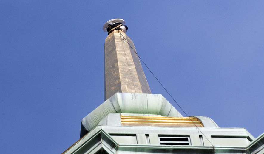 In this file photo, a midshipmen's cap is shown placed at the tip of the spire on the top of Naval Academy Chapel in Annapolis, Md., Monday, Dec. 11, 2017.   (Joshua McKerrow/The Baltimore Sun via AP) **FILE**