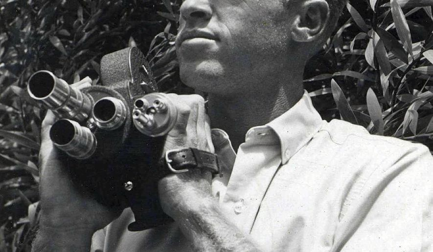 In This Undated Photo Provided By Bruce Brown Films Filmmaker Holds A Camera