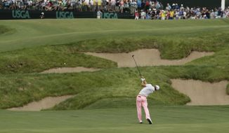 FILE - In this June 17, 2017, file photo, Justin Thomas hits to the 18th green during the third round of the U.S. Open golf tournament, at Erin Hills in Erin, Wis. His 3-wood set up an eagle and a 63, the best shot with that club this year on the PGA Tour. (AP Photo/A Charlie Riedel, File) **FILE**