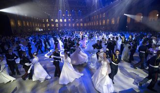 Military school students dance during their annual ball in Moscow, Russia, Tuesday, Dec. 12, 2017. The ball attracts the youth from all over Russia. (AP Photo/Alexander Zemlianichenko)