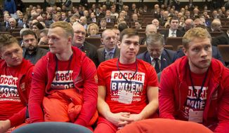 Russian ice hockey players with the words 'Russian is in my heart' on their sweatshirts attend an Russian Olympic committee meeting in Moscow, Russia, Tuesday, Dec. 12, 2017. Russia's Olympic Committee said on Tuesday that Russian athletes are overwhelmingly in favor of competing at the 2018 Winter Games despite a ban on the national team. (AP Photo/Ivan Sekretarev)