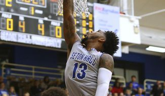 Seton Hall's Myles Powell (13) attempts a shot as St. Peter's Davauhnte Turner (1) defends during the first half of an NCAA college basketball game in South Orange, N.J., Tuesday, Dec. 12, 2017. Seton Hall defeated St. Peter's 84-61. (AP Photo/Rich Schultz)