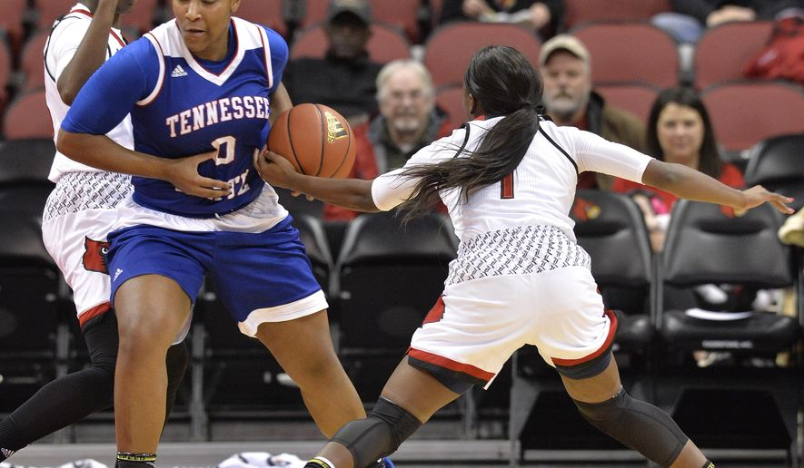 Louisville guard Dana Evans, right, attempts to strip the ball away from Tennessee State guard Taylor Roberts, left, during the first half of an NCAA college basketball game, Tuesday, Dec. 12, 2017, in Louisville, Ky. (AP Photo/Timothy D. Easley)