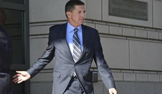 FILE - In this Dec. 1, 2017 file photo, former Trump national security adviser Michael Flynn leaves federal court in Washington.  People close to Flynn are telling The Associated Press about the emotional pressures he faced in the past year as special counsel Robert Mueller closed in on him and also investigated his son. (AP Photo/Susan Walsh)