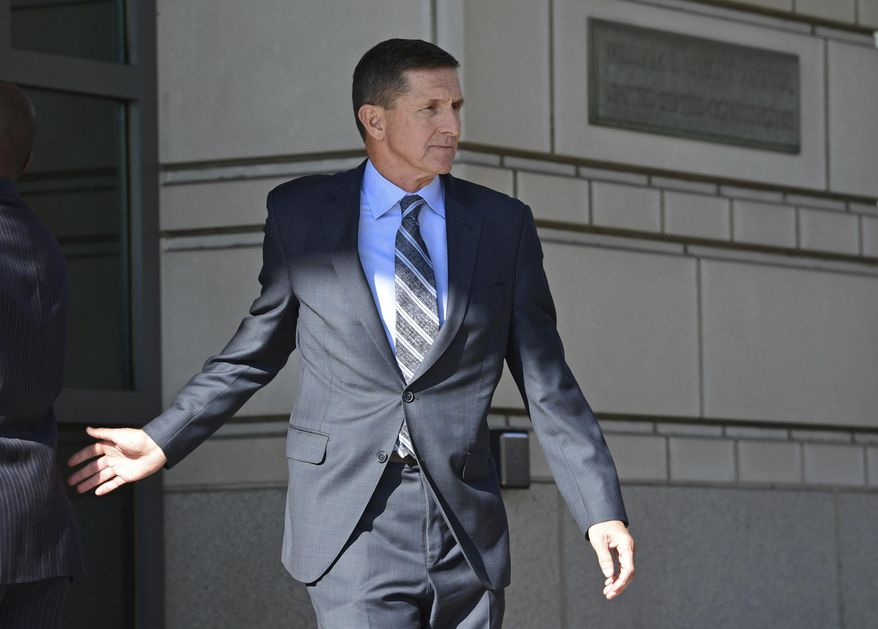In this Dec. 1, 2017, file photo, former Trump National Security Adviser Michael Flynn leaves federal court in Washington. (AP Photo/Susan Walsh) ** FILE **