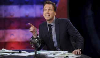 "This Sept. 25, 2017 image released by Comedy Central shows comedian Jordan Klepper hosting the premiere of ""The Opposition w/ Jordan Klepper"" in New York. Adapting to the current media ethos with its ever harsher, ever more absurdist pitch, Klepper hosts a supercharged version of ""The Colbert Report,"" whose time slot he inherited in September when he unveiled his fake rantcast. (Brad Barket/Comedy Central via AP)"
