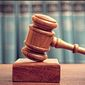 A gavel is shown against a backdrop of law books in this undated stock photo. (Associated Press) ** FILE **