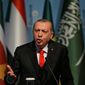 "Turkish President Recep Tayyip Erdogan, who hosted the emergency IOC summit in a bid to unify the Muslim world's response to the U.S. policy shift, accused Israel in a speech of being ""a state of terror"" and vowed to ""stand up to American bullying."""