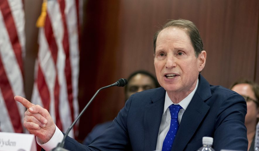 Sen. Ron Wyden of Oregon, the top Democrat on the Senate Finance Committee, speaks during a House and Senate conference after GOP leaders announced they have forged an agreement on a sweeping overhaul of the nation's tax laws, on Capitol Hill in Washington on Dec. 13, 2017. (Associated Press) **FILE**
