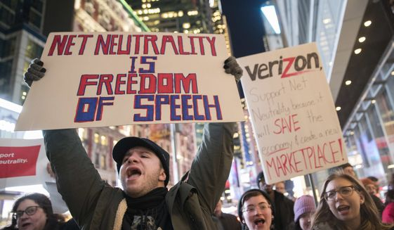 In this Thursday, Dec. 7, 2017, file photo, demonstrators rally in support of net neutrality outside a Verizon store in New York. The Federal Communications Commission is voting Thursday, Dec. 14, to undo Obama-era net neutrality rules that guaranteed equal access to the internet. The industry promises that the internet experience isnt going to change, but the issue has struck a nerve. Protests have erupted online and in the streets as everyday Americans worry that companies like Comcast, Verizon and AT&T will be able to control what they see and do online. (AP Photo/Mary Altaffer, File) **FILE**