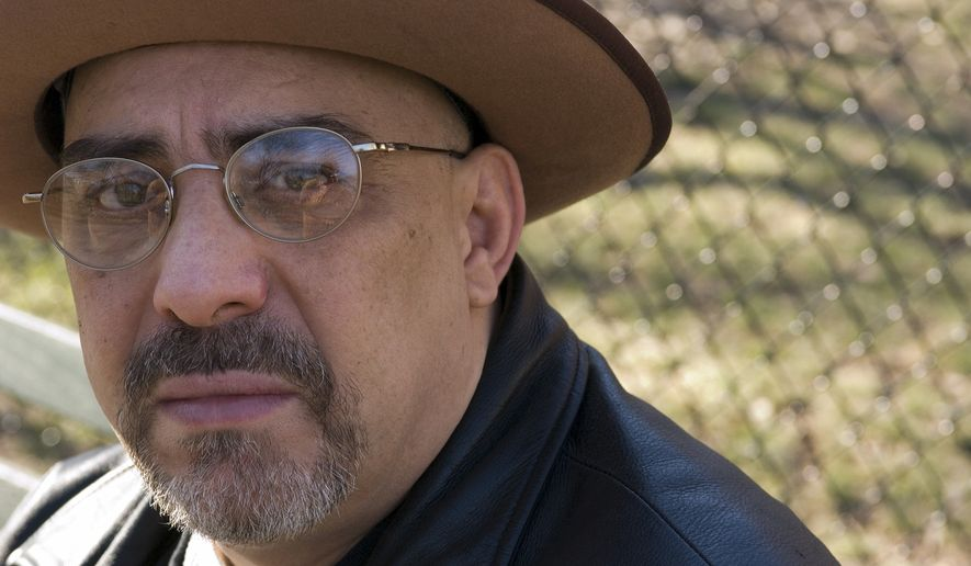 In this Feb. 3, 2007, file photo, Pat DiNizio of Smithereens poses for a photograph in New York. DiNizio, lead singer and songwriter of the New Jersey rock band died at age 62. The band announced on Facebook that DiNizio died Tuesday, Dec. 12, 2017. (AP Photo/Jim Cooper, FIle)