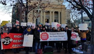 About 80 protesters gathered on Unity Park in Northwest D.C. Wednesday, Dec. 13, 2017, to protest the subcontractor Power Design. (The Washington Times/Julie Airey)