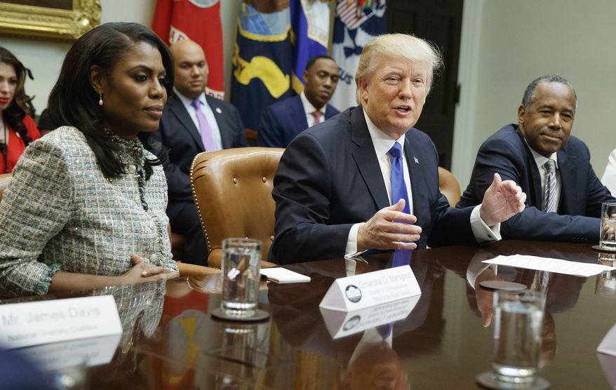 Donald Trump speaks during a meeting on African American History Month in the Roosevelt Room of the White House in Washington, Wednesday, Feb. 1, 2017. From left are, Omarosa Manigault, Trump, Housing and Urban Development Secretary-designate Ben Carson, and Lynne Patton. (AP Photo/Evan Vucci) ** FILE **