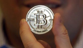 Bitcoin is classified by the U.S. as a taxable asset similar to a house or boat. (Associated Press/File)
