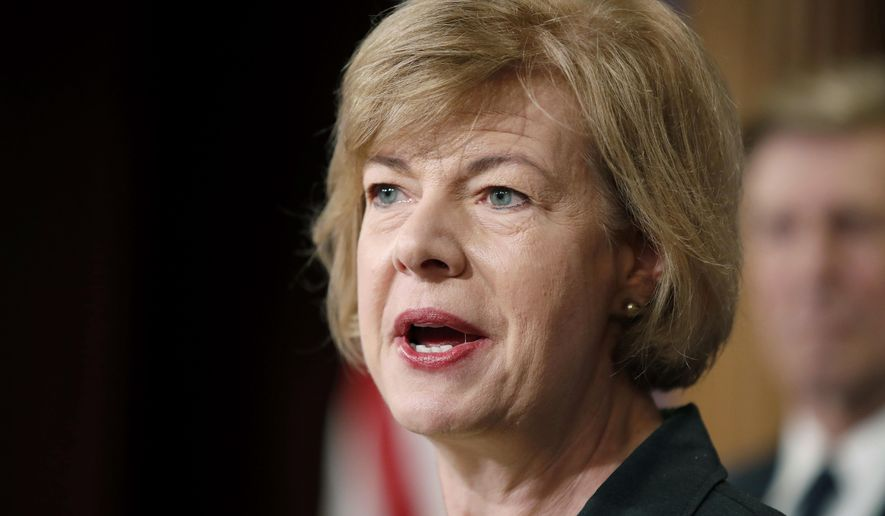FILE - In this April 25, 2017 file photo, Sen. Tammy Baldwin, D-Wis., speaks on Capitol Hill in Washington. Wisconsin Democrats were hopeful Wednesday, Dec. 13 that the defeat of scandal-plagued Republican Roy Moore by Democrat Doug Jones in Tuesday night's special election in Alabama means voters are turning against the GOP across the country, especially those party members with close ties to President Donald Trump. Baldwin is up for re-election in 2018 along with Republican Gov. Scott Walker. The two races are the most prominent statewide contests next year in Wisconsin, with more than a dozen Democrats vying for a chance to take on Walker. (AP Photo/Alex Brandon, File)