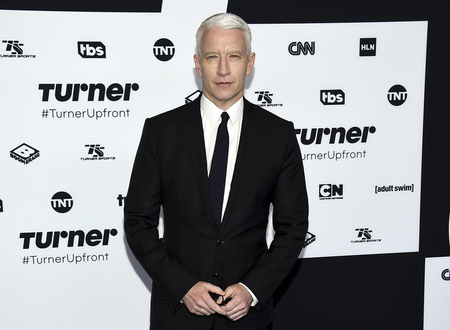 """FILE - In this May 17, 2017, file photo, CNN News anchor Anderson Cooper attends the Turner Network 2017 Upfront presentation at The Theater at Madison Square Garden in New York. CNN is claiming Wednesday, Dec. 13, that Cooper's Twitter account was hacked after a tweet from his handle called the president a """"pathetic loser"""" following Democrat Doug Jones winning Alabama's special Senate election. (Photo by Evan Agostini/Invision/AP, File)"""