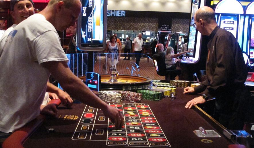 In this June 24, 2016 photo, gamblers play a game of roulette at the Golden Nugget casino in Atlantic City N.J. Figures released on Wednesday Dec. 13, 2017 shows that Atlantic City's seven casinos saw their revenue increase by 4.6 percent in November compared to the levels of a year ago. (AP Photo/Wayne Parry)