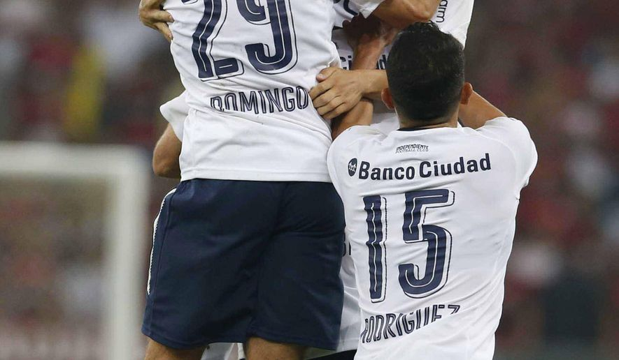 Argentina's Independiente's Ezequiel Barco, facing camera, celebrates his goal against Brazil's Flamengo with teammate Nicolas Domingo, left, and Diego Rodriguez during the Copa Sudamericana final championship soccer match at Maracana stadium in Rio de Janeiro, Brazil, Wednesday, Dec.13, 2017. (AP Photo/Leo Correa)