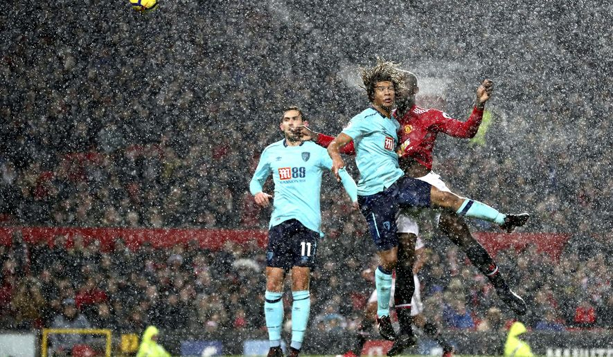 Manchester United's Romelu Lukaku, centre right, scores his side's first goal of the game during the English Premier League soccer match between Manchester United and Bournemouth, at Old Trafford, in Manchester, England, Wednesday, Dec. 13, 2017.  (Martin Rickett/PA via AP)