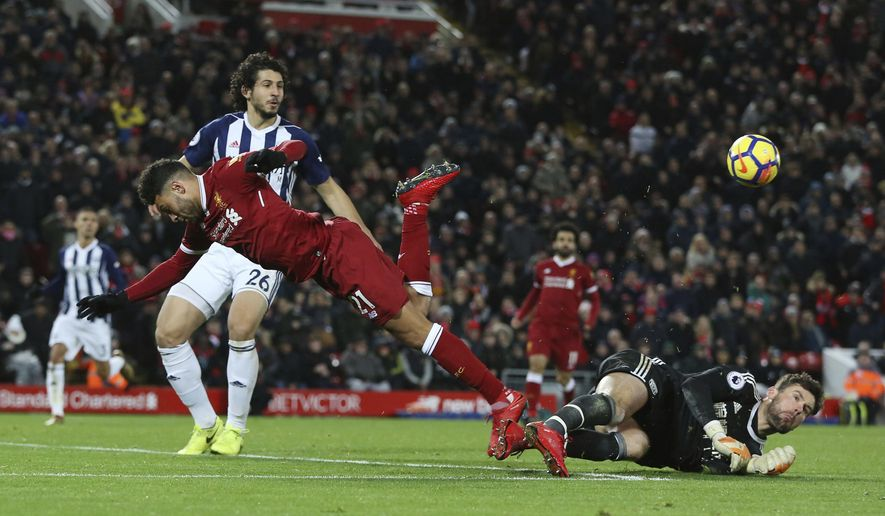 Liverpool's Alex Oxlade-Chamberlain goes down in the box during the game against West Bromwich Albion during their English Premier League soccer match at Anfield in Liverpool, England, Wednesday Dec. 13, 2017. (Peter Byrne/PA via AP)