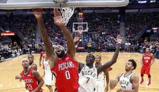 New Orleans Pelicans center DeMarcus Cousins (0) goes to the basket against Milwaukee Bucks center Thon Maker (7) in the first half of an NBA basketball game in New Orleans, Wednesday, Dec. 13, 2017. (AP Photo/Gerald Herbert)