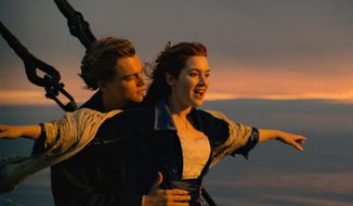 "This image released by Paramount Pictures shows Leonardo DiCaprio, left, and Kate Winslet in a scene from ""Titanic.""  The film is among the 25 movies being added to the prestigious National Film Registry. (Paramount Pictures via AP)"