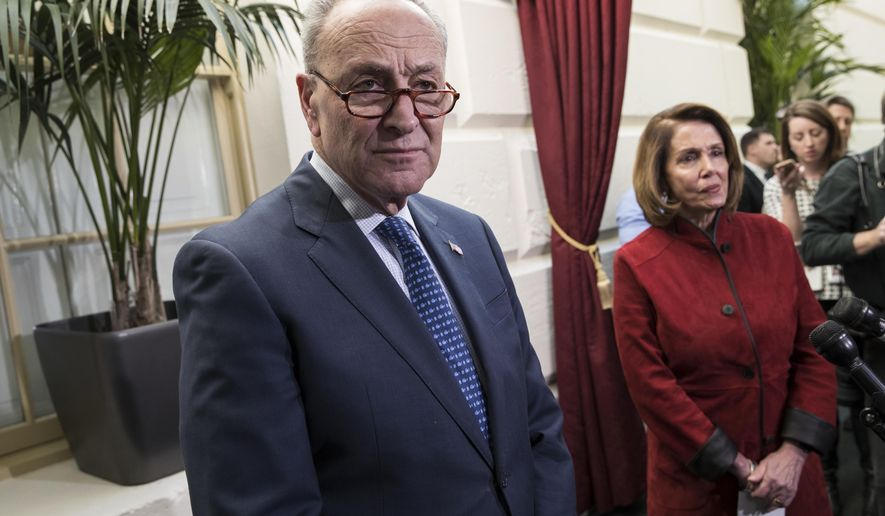 Senate Minority Leader Chuck Schumer, D-N.Y., and House Minority Leader Nancy Pelosi, D-Calif., right, speak to reporters just before House and Senate tax bill conferees meet to work on the sweeping overhaul of the nation's tax laws, on Capitol Hill in Washington, Wednesday, Dec. 13, 2017. Democrats are objecting to the bill and are asking that a final vote be delayed until Senator-elect Doug Jones of Alabama is seated. (AP Photo/J. Scott Applewhite)