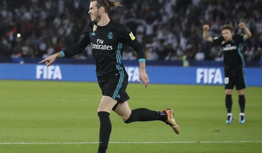 Real Madrid's Gareth Bale celebrates after scoring his side second goal during the Club World Cup semifinal soccer match between Real Madrid and Al Jazira Club at Zayed sport city in Abu Dhabi, United Arab Emirates, Wednesday, Dec. 13, 2017. (AP Photo/Hassan Ammar)