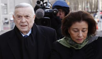 Jose Maria Marin, of Brazil, left, arrives to federal court in the Brooklyn borough of New York, Wednesday, Dec. 13, 2017. Closing arguments are set to take place in the New York trial of three former South American soccer officials charged in the bribery scandal engulfing the sport's governing body. (AP Photo/Seth Wenig)