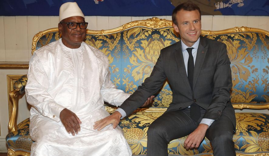 FILE - In this photo dated Tuesday, Oct. 31, 2017 the President of Mali, Ibrahim Boubacar Keita, left, sits with French President Emmanuel Macron before talks at the Elysee Palace in Paris. President Francois Macron is convening presidents, princes and diplomats on Wednesday to breath life into a young African military force with a mission to counter the growing threat jihadi threat in the Sahel region but which is struggling to come alive. (Charles Platiau, Pool via AP, File)