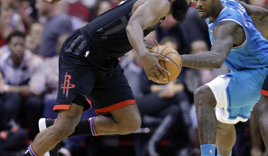 Houston Rockets guard James Harden (13) drives around Charlotte Hornets guard Michael Carter-Williams (10) during the first half of an NBA basketball game Wednesday, Dec. 13, 2017, in Houston. (AP Photo/Michael Wyke)