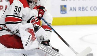 Carolina Hurricanes goalie Cam Ward makes a save during the first period of an NHL hockey game against the Vegas Golden Knights, Tuesday, Dec. 12, 2017, in Las Vegas. (AP Photo/Isaac Brekken)