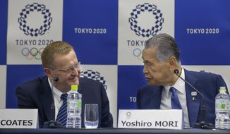 International Olympic Committee (IOC) Vice President John Coates, left, chats with Tokyo 2020 Olympics President Yoshiro Mori during a joint press conference in Tokyo, Wednesday, Dec. 13, 2017. (AP Photo/Shizuo Kambayashi)