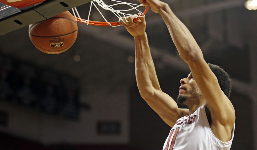 Texas Tech's Zach Smith (11) dunks the ball during an NCAA college basketball game against Kennesaw State, Wednesday, Dec. 13, 2017, in Lubbock, Texas. (AP Photo/Brad Tollefson)