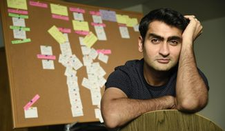 """In this Nov. 21, 2017 photo, actor-comedian Kumail Nanjiani, co-writer and star of the film """"The Big Sick,"""" poses for a portrait in front of a billboard of script notecards at his home in Los Angeles. Nanjiani was named as one of 2017's breakthrough entertainers by the Associated Press. (Photo by Chris Pizzello/Invision/AP)"""