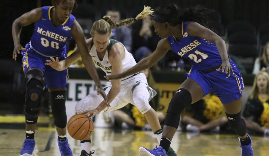 Baylor guard Kristy Wallace, center, reaches for a loose ball with McNeese State guard Keara Hudnall, left, and forward Mercedes Rogers, right, in the first half of an NCAA college basketball game, Wednesday, Dec. 13, 2017, in Waco, Texas. (Rod Aydelotte/Waco Tribune-Herald via AP)