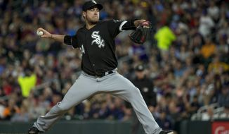 FILE - In this June 20, 2017, file photo, Chicago White Sox relief pitcher Anthony Swarzak throws to the Minnesota Twins during the sixth inning of a baseball game, in Minneapolis.  A person familiar with the contract tells The Associated Press that free-agent reliever Anthony Swarzak has reached a deal with the New York Mets. The person spoke on condition of anonymity Wednesday, Dec. 13, 2017,  at the winter meetings because Swarzak still needed to complete a physical. Swarzak is set to get $14 million over two years. (AP Photo/Bruce Kluckhohn, File)