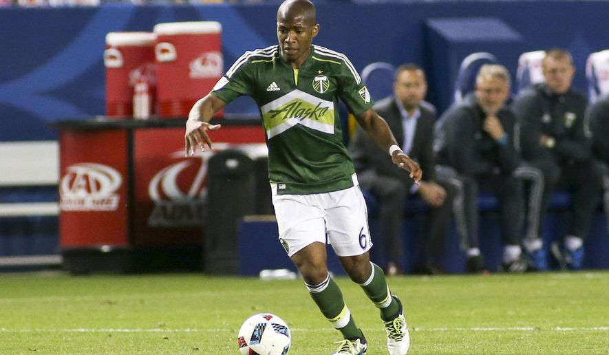 FILE - In this Sunday April 10, 2016 file photo, Portland Timbers midfielder/forward Darlington Nagbe (6) moves the ball against the Los Angeles Galaxy during an MLS soccer game in Carson, Calif. The Portland Timbers have traded midfielder Darlington Nagbe to Atlanta United in exchange for as much as $1.65 million in allocation money, Wednesday, Dec. 13, 2017. (AP Photo/Ringo H.W. Chiu, File)