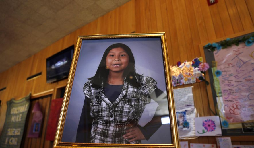 FILE - This May 6, 2016 file photo shows a portrait of 11-year-old Ashlynne Mike, who was abducted and murdered in 2016, on display inside the lobby of the Farmington Civic Center in Farmington, N.M. A Native American tribe that spans three western states is closer to having its own system for alerting the public when children go missing or there are other emergencies such as wildfires, hazardous waste spills or road closures. The Navajo Nation has signed a contract to purchase software to finally implement an emergency notification system. (Jon Austria/The Daily Times via AP, File)