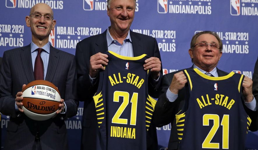 NBA Commissioner Adam Silver, left, is joined by Indiana Pacers owner Herb Simon, right, and Larry Bird, after he announced in Indianapolis, Wednesday, Dec. 13, 2017 that Indianapolis will host the 2021 NBA All-Star game . (AP Photo/Michael Conroy)