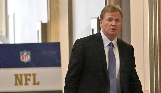 NFL Commissioner Roger Goodell walks in a hallway during a break at the NFL owners' winter meeting in Irving, Texas, Wednesday, Dec. 13, 2017. (AP Photo/LM Otero)