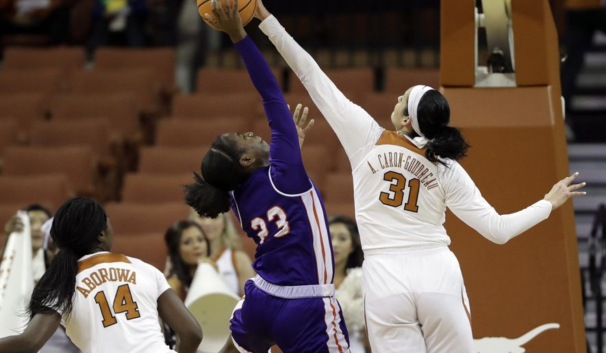Northwestern State forward Jocelyn Scott (23) is blocked by Texas forward Audrey-Ann Caron-Goudreau (31) as she tries to score during the first half of an NCAA college basketball game, Wednesday, Dec. 13, 2017, in Austin, Texas. (AP Photo/Eric Gay)