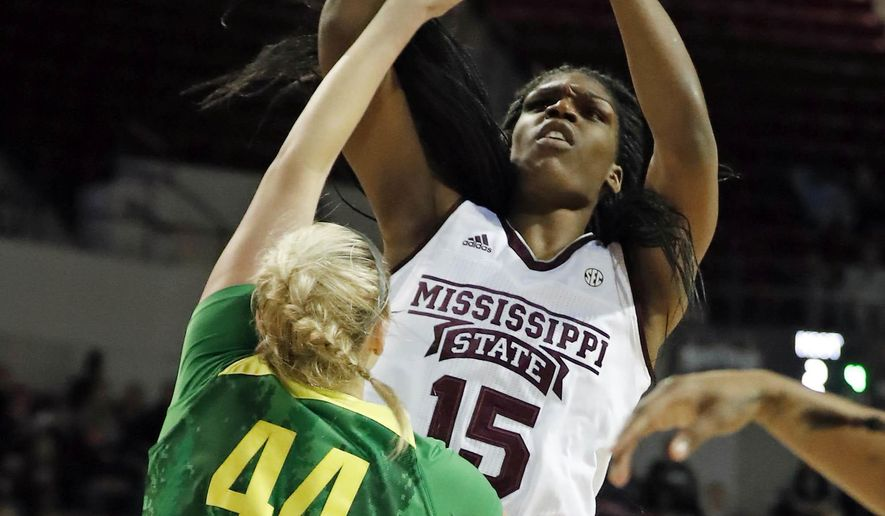 Mississippi State center Teaira McCowan (15) shoots at the basket over Oregon forward Mallory McGwire (44) in the first half of their NCAA college basketball game in Starkville, Miss., Wednesday, Dec. 13, 2017. (AP Photo by Rogelio V. Solis)