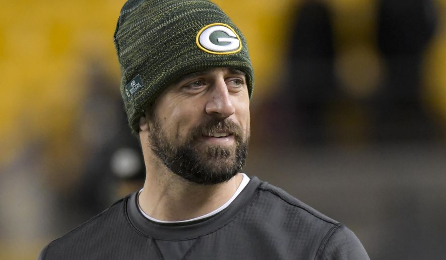 "In this Nov. 26, 2017, photo, Green Bay Packers quarterback Aaron Rodgers watches warmups before an NFL football game against the Pittsburgh Steelers in Pittsburgh. Rodgers has been ""medically cleared to return"" to action after missing seven games with a broken right collarbone, the quarterback announced on Instagram Tuesday night, Dec. 12. (AP Photo/Don Wright) **FILE**"